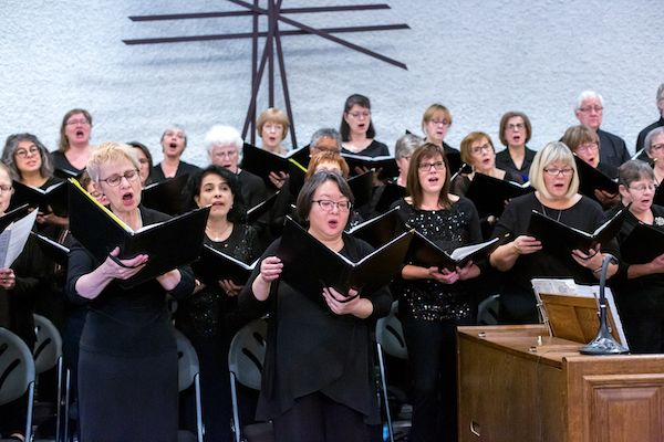 Female choir members singing